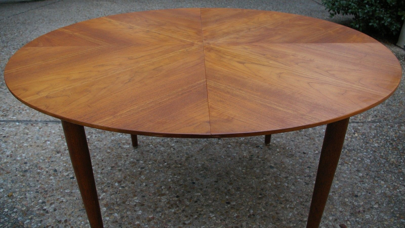 This Oval Shaped Dining Table Is Made Of European Walnut With A