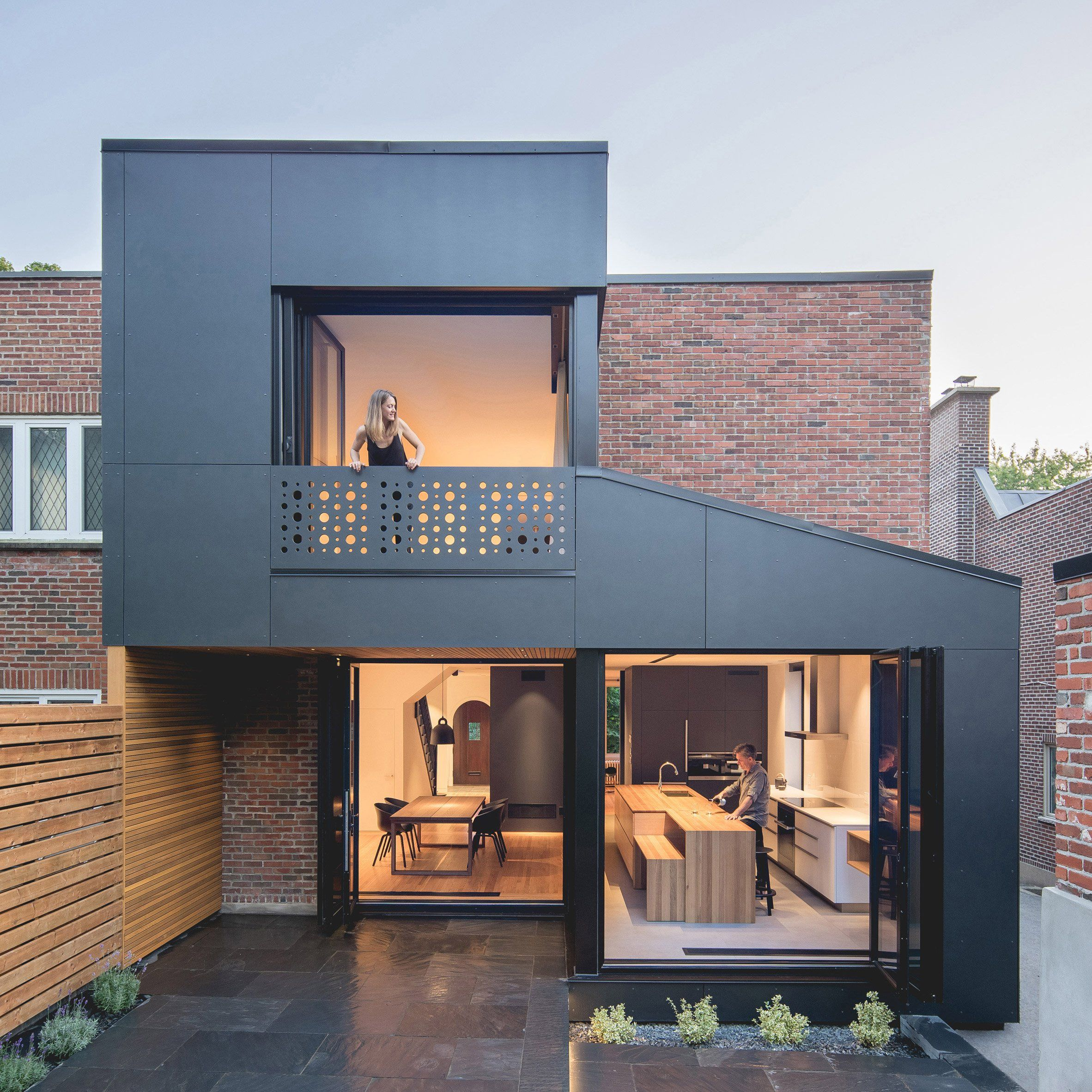 Architect Natalie Dionne has attached a geometric extension to the back of a brick townhouse in Montreal, to include more space in the kitchen and bedroom.