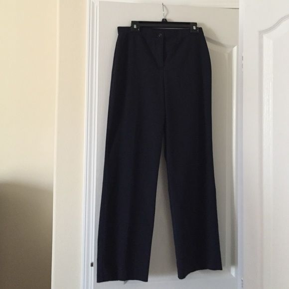 Ladies dark navy slacks Unlined excellent condition, machine wash and dry, wrinkle free. Dark navy no pockets. Button and zipper front. Full rear and leg. Polyester, rayon, and spandex (stretchy feeling waistband). Brand is David dart Pants Trousers