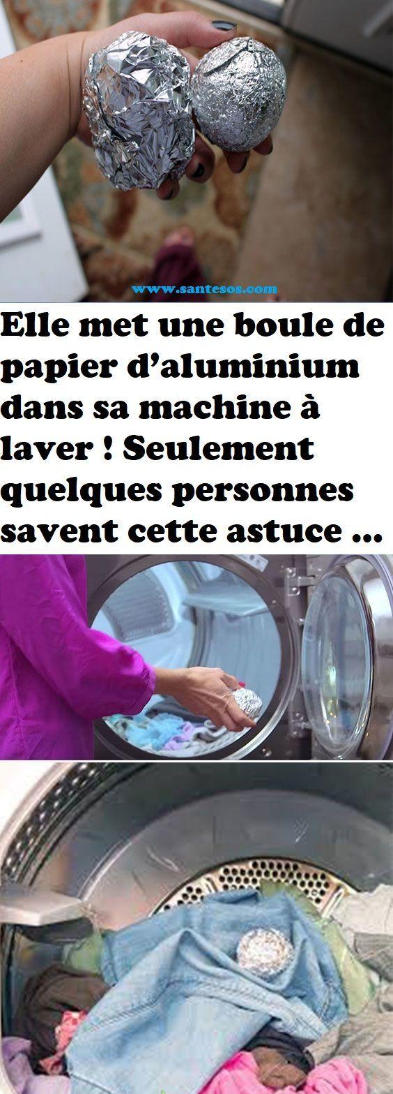 elle met une boule de papier d'aluminium dans sa machine à laver