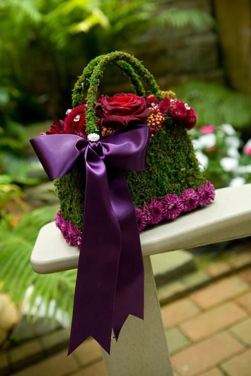 moss purse accented with mini mums and satin ribbon