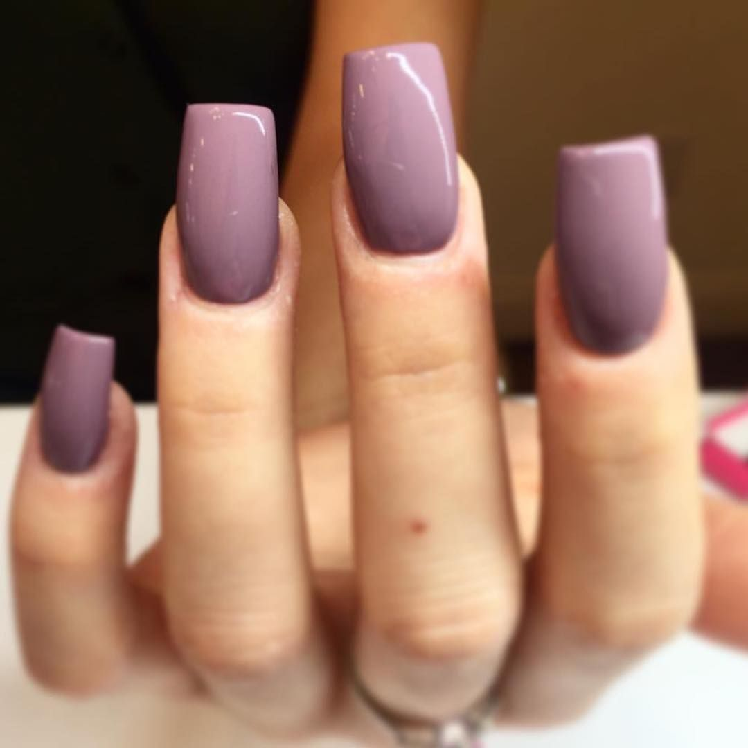 Love that pretty plum color, not the length/shape of those nails ...
