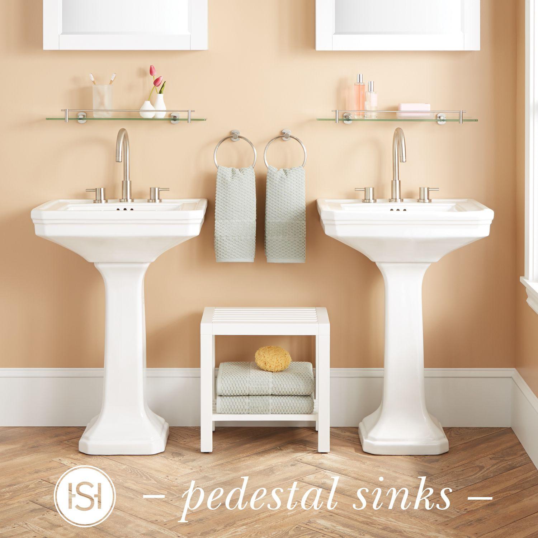 a crisp white porcelain pedestal sink