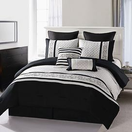 Refresh your master suite or guest room with this lovely comforter set, showcasing embroidered details and a black and white hue.