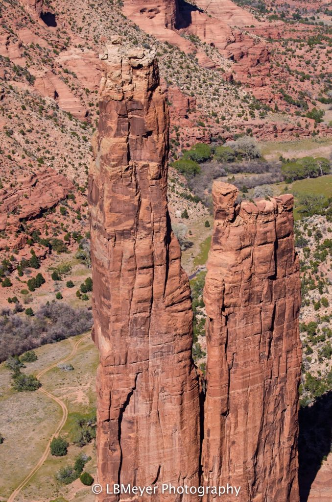 Spider Rock. You can judge how tall the spires are by looking at the tiny trail at the bottom of the valley floor. Canyon de Chelly is on Indian land near Chinle, AZ