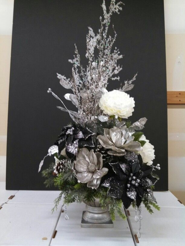 Silver black and white christmas floral arrangement at