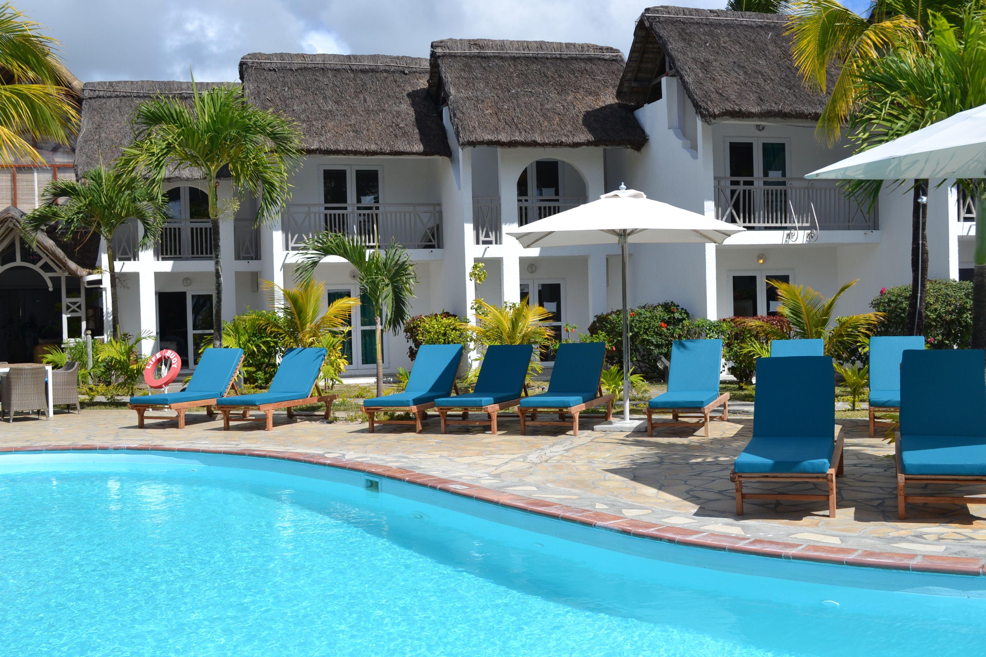 The Swimming Pool Area At Veranda Palmar Beach Mauritius Palmar Beach Swimming Pools Pool Area