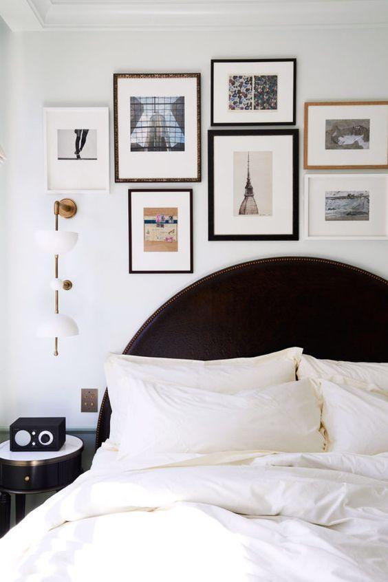 black and white bedroom with art gallery wall photographed by nicole franzen. / #nicolefranzen #bed #bedroom #blackbed #artgallerywall #wallart #artwork #artwall #homegallery #bedroom #blackandwhitedecor #bedsidetable #modernbedroom #whitebedding #whitesheets #bedding