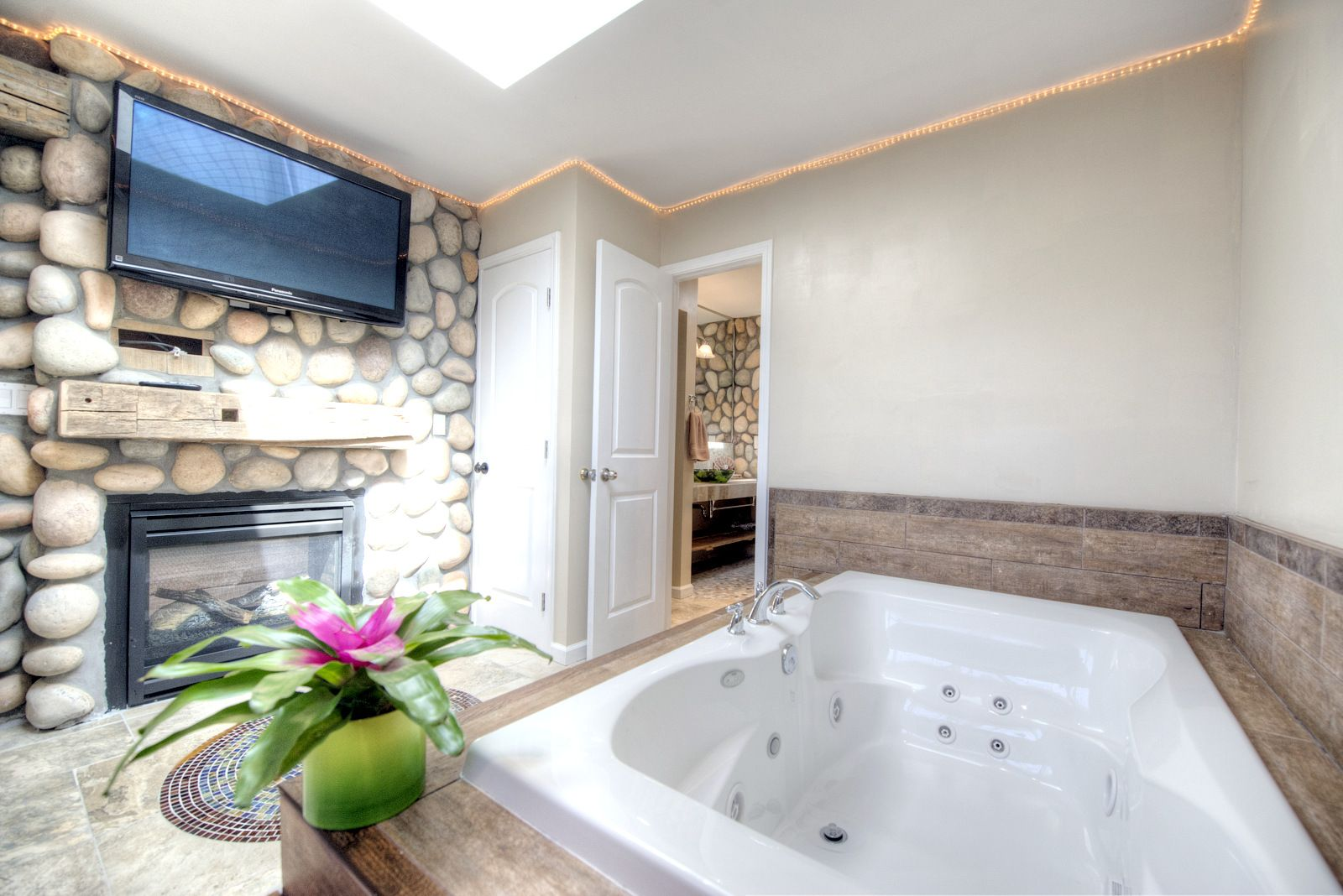 Relax In Your Jacuzzi Tub While Enjoying The Fireplace And