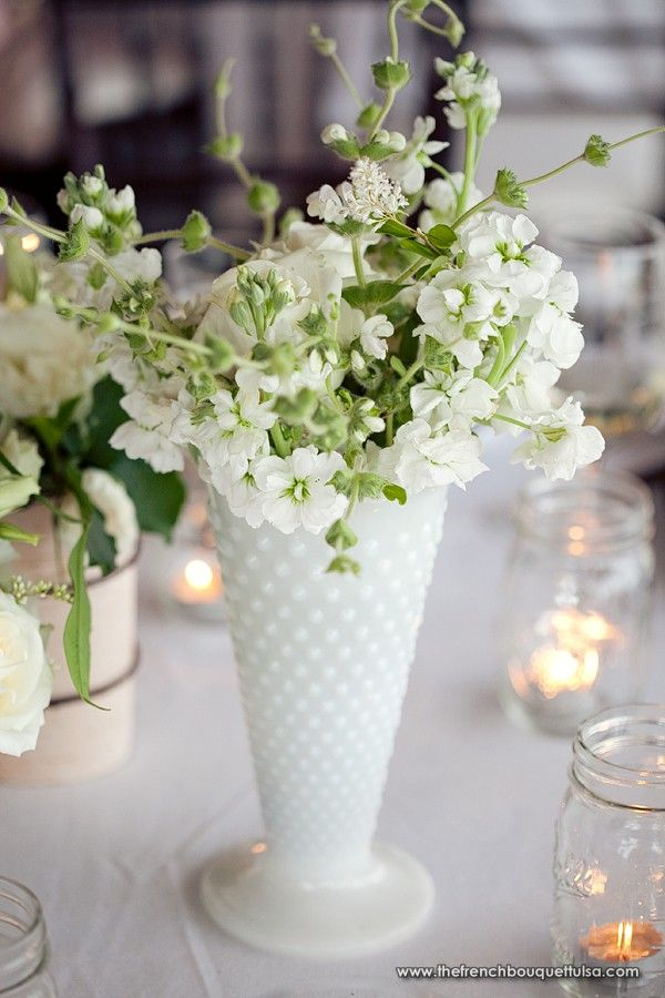 Floral arrangement in white milk glass vase the french