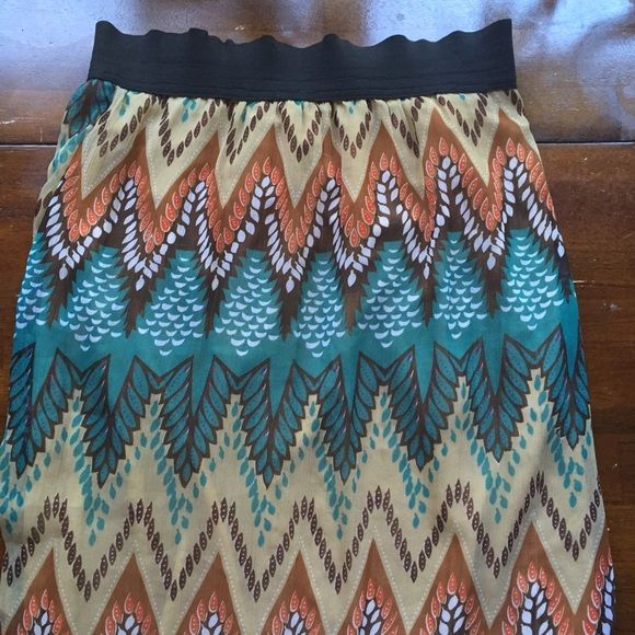 "Pattern Maxi Skirt Fall colored maxi skirt with knee-length slip attached underneath. From the knee down the material is sheer. Elastic waistband and very comfortable. I'm 5'3"" and it stops about an inch off of the floor. Skirts Maxi"