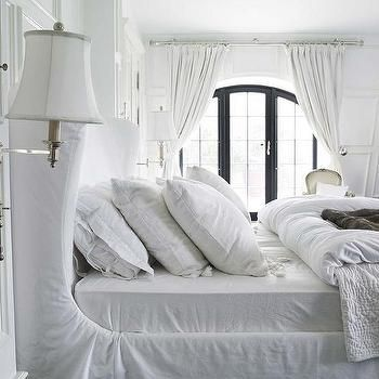 white wingback bed with slipcover