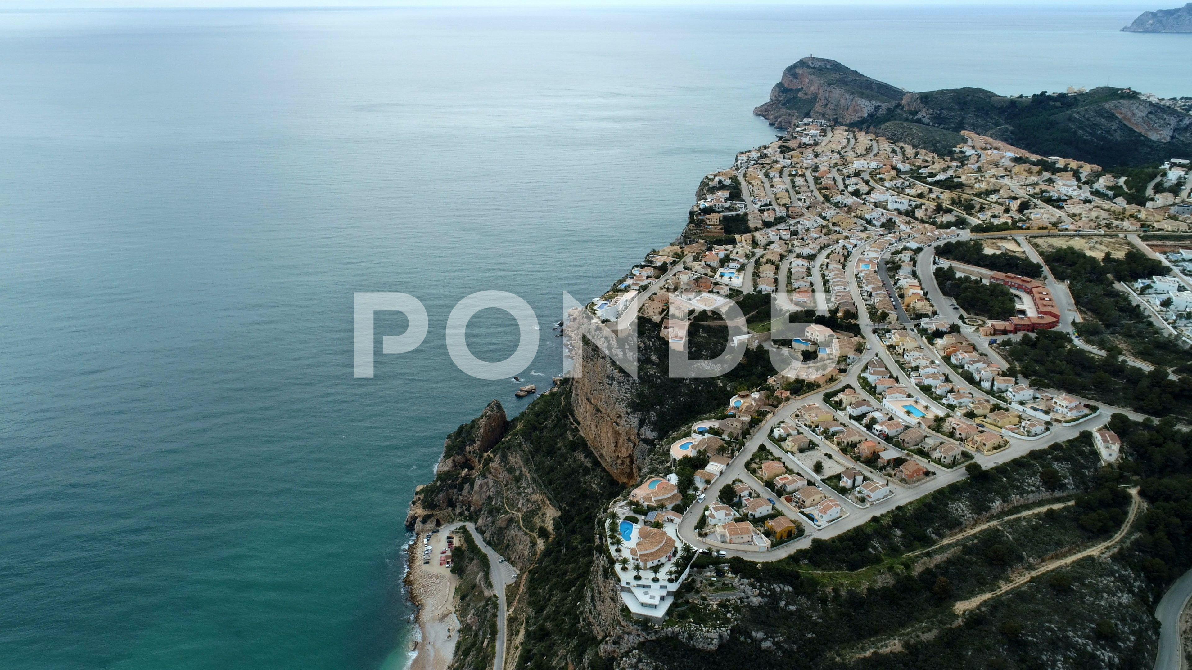 Cliff Hotel Villa Sea Water Nature Spain Aerials 4k Drone Stock Footage SeaWaterVillaCliff