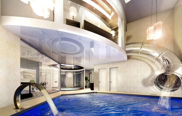Indoor pool with waterslide  totally normal...what every average person has in their house ...