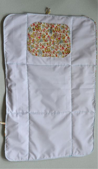 shower curtain; diaper pouch and changing pad.