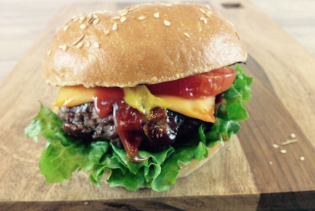 Here's an awesome burger recipe to serve at your next barbecue.  These juicy burgers are adorned with melted cheese, sliced tomatoes, lettuce, and (of course) ketchup and mustard.
