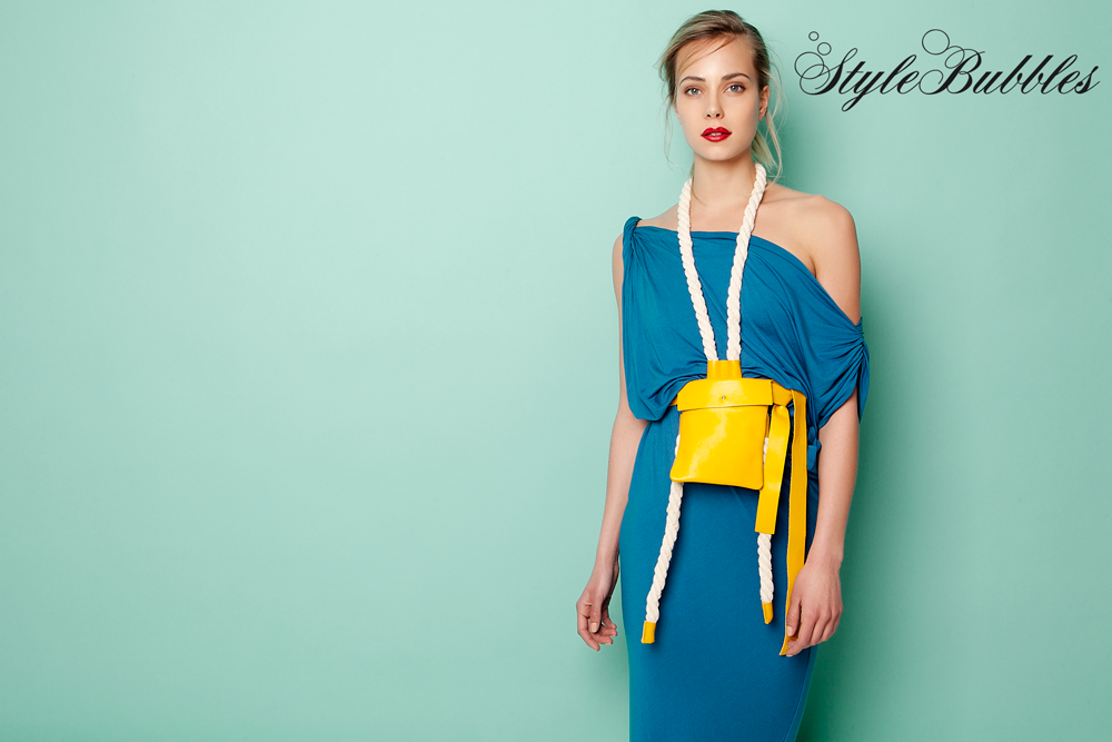 """Dare to upgrade your body shape in this Blue """"Twisted Shoulder"""" dress by Ioanna Kourbela and boost your style to the max, combining it with the yellow belt bag! #StyleBubbles #IoannaKourbela #SummerEssentials #onlineshopping"""