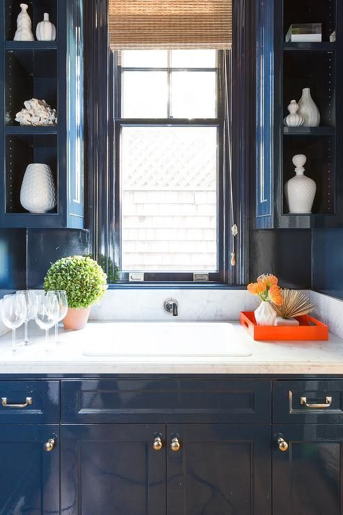 Blue Kitchen With Glossy Blue Lacquered Cabinets Adorned With Nickel Hardware Topped With Honed White Marble Kitchen Tiles Design Kitchen Design Kitchen Marble