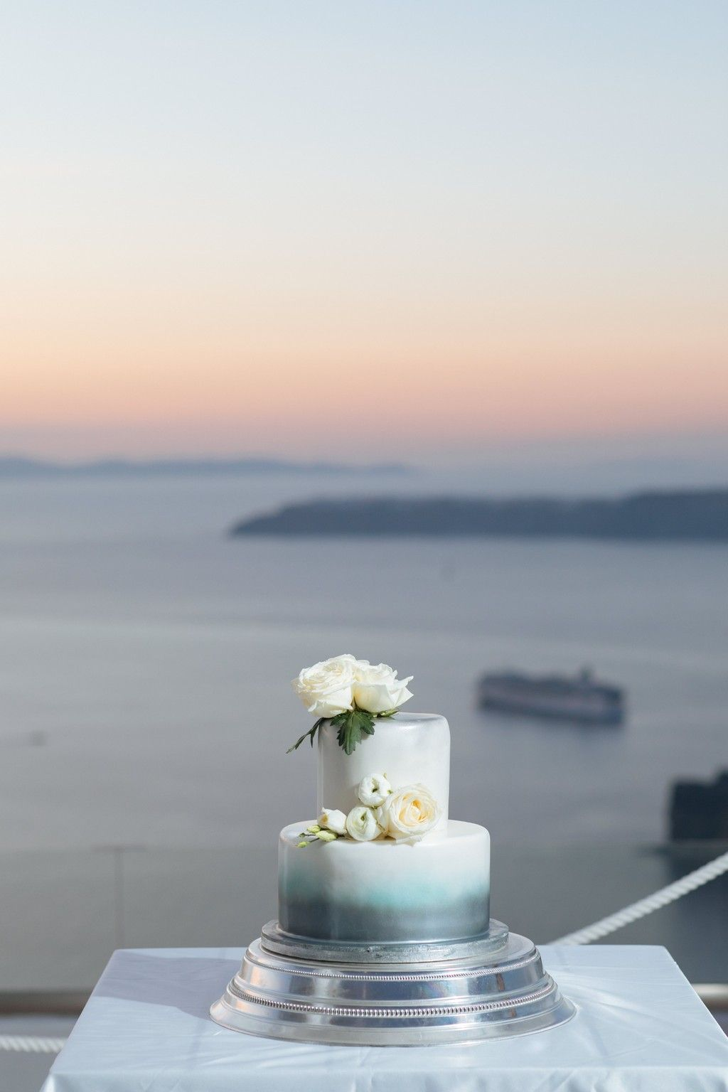 Blue silver wedding cake santorini sunset wedding planners