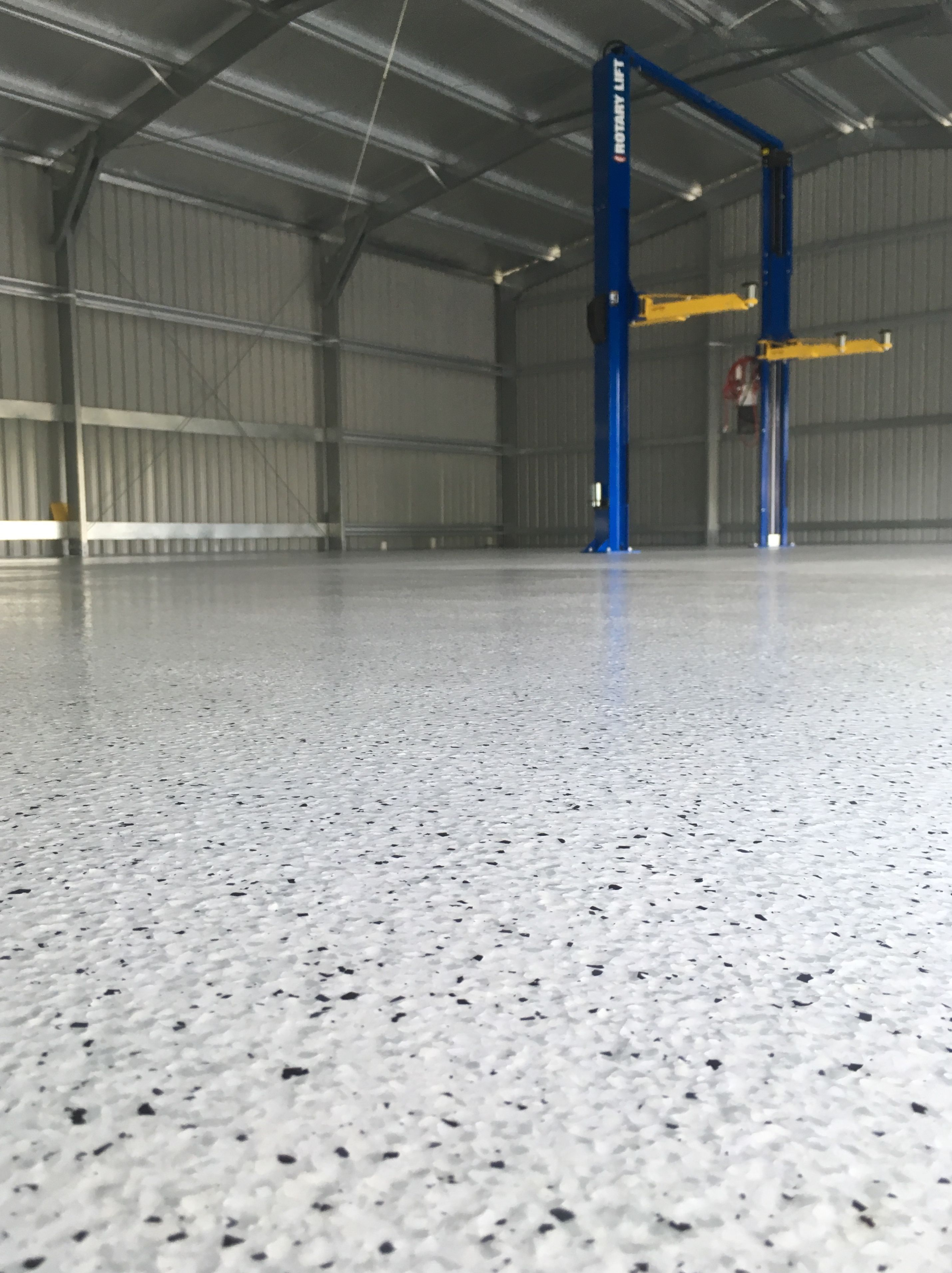A Large 190 Sqm Narangba Shed Floor Received A Makeover With Our Flake Epoxy Flooring Installation Servicing Sunshine Coast To Bri Shed Floor Shed Epoxy Floor