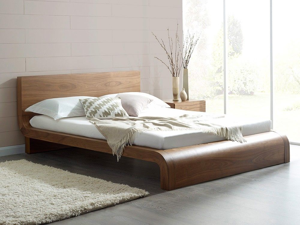 Walnut contemporary bed with beautiful curves And so to bed