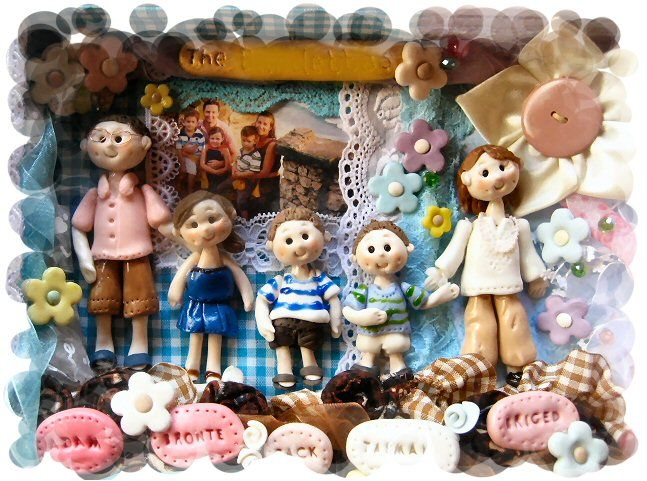 Adam's happy family. Clay dolls in a frame.