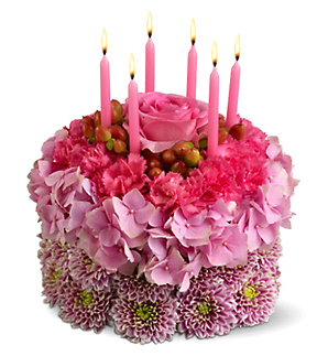 Three tones pink fresh flowers bithday cakes with pink candlesPNG
