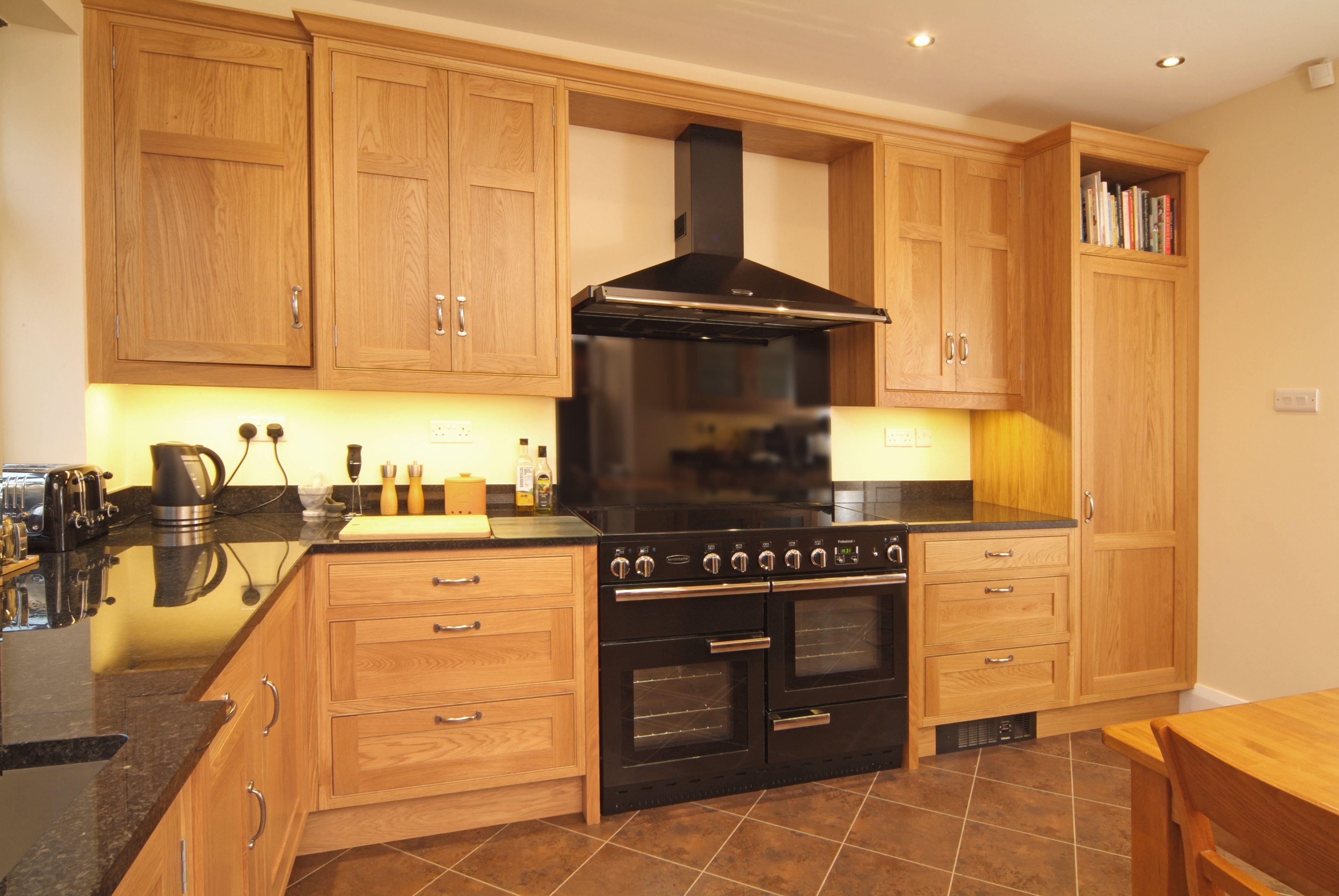 Oak shaker kitchen with black splash back woodenverticalblinds