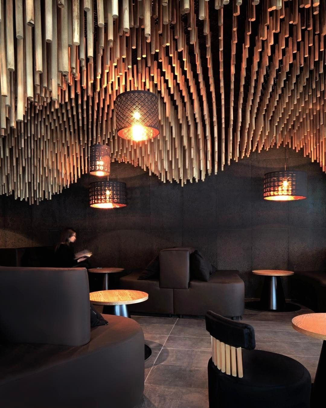 A 3 d printed sculptural canopy of over 7000 wooden for Raumgestaltung restaurant