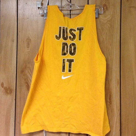 NWOT nike tank New with out tags. Wear oversized with cute sports bra and leggings and you are hood to go:) Nike Tops Muscle Tees