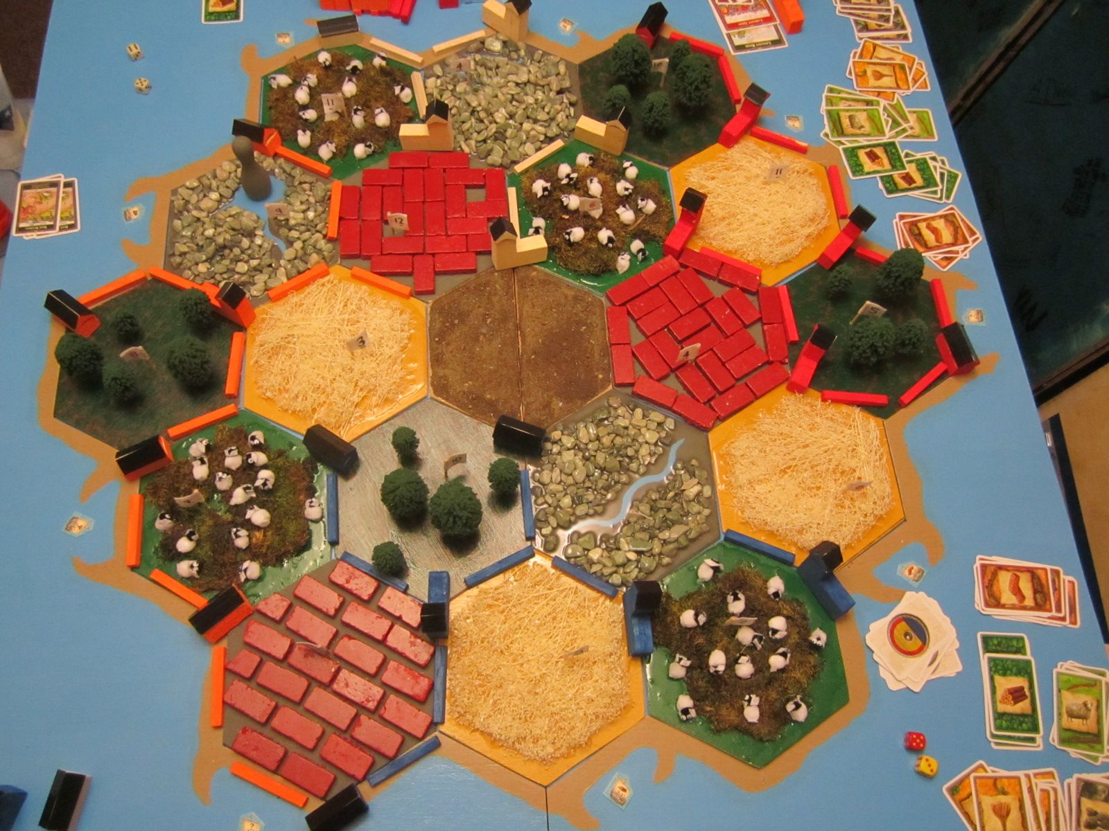 4'x4' wooden Settlers of Catan board. Players use