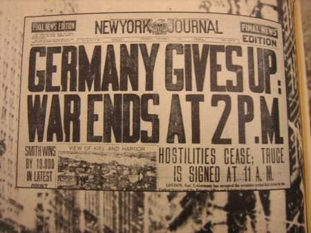 A newspaper headlining the end of World War 1. The Treaty of ...