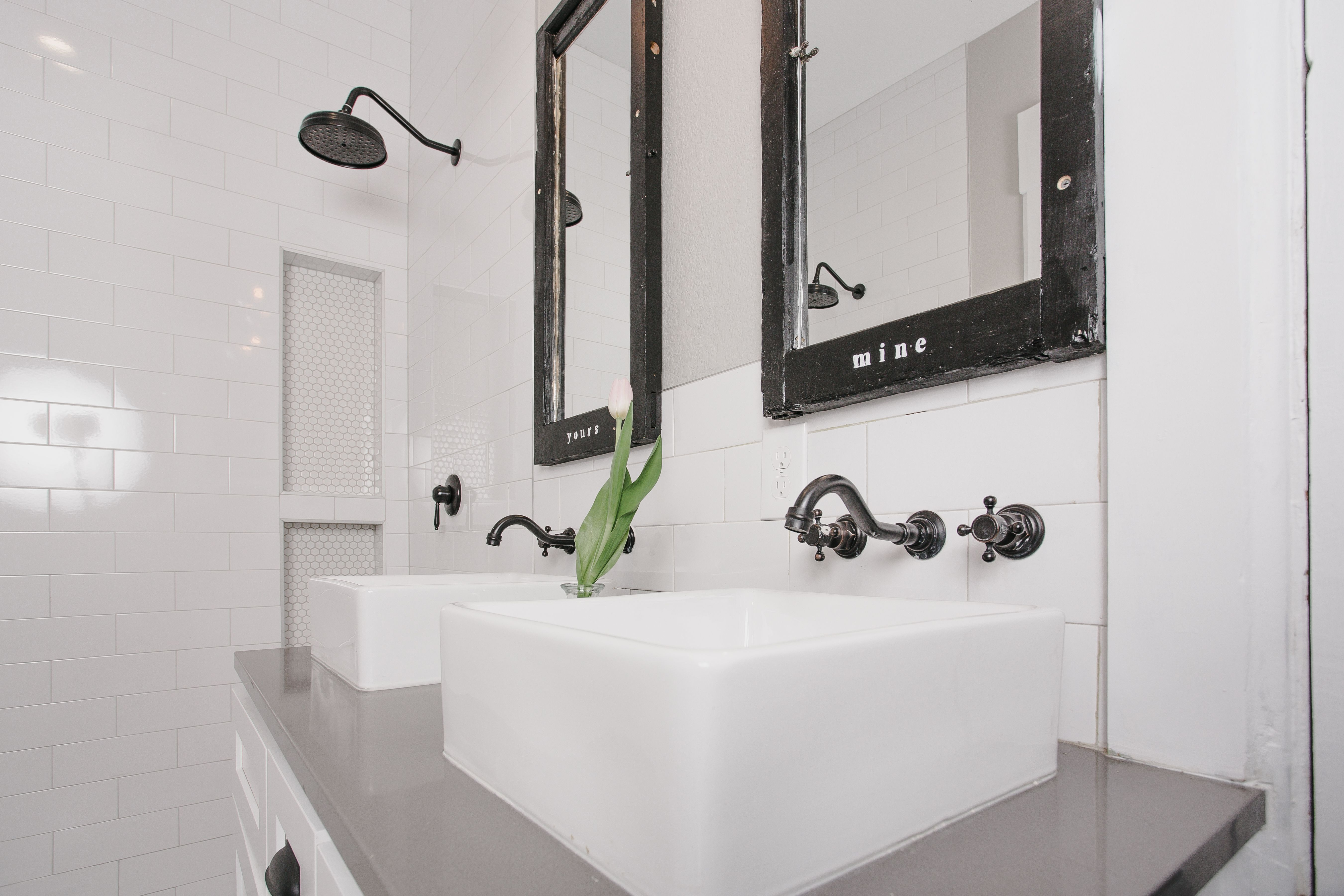 Wall mounted faucets and pops of black against the white looks crisp ...