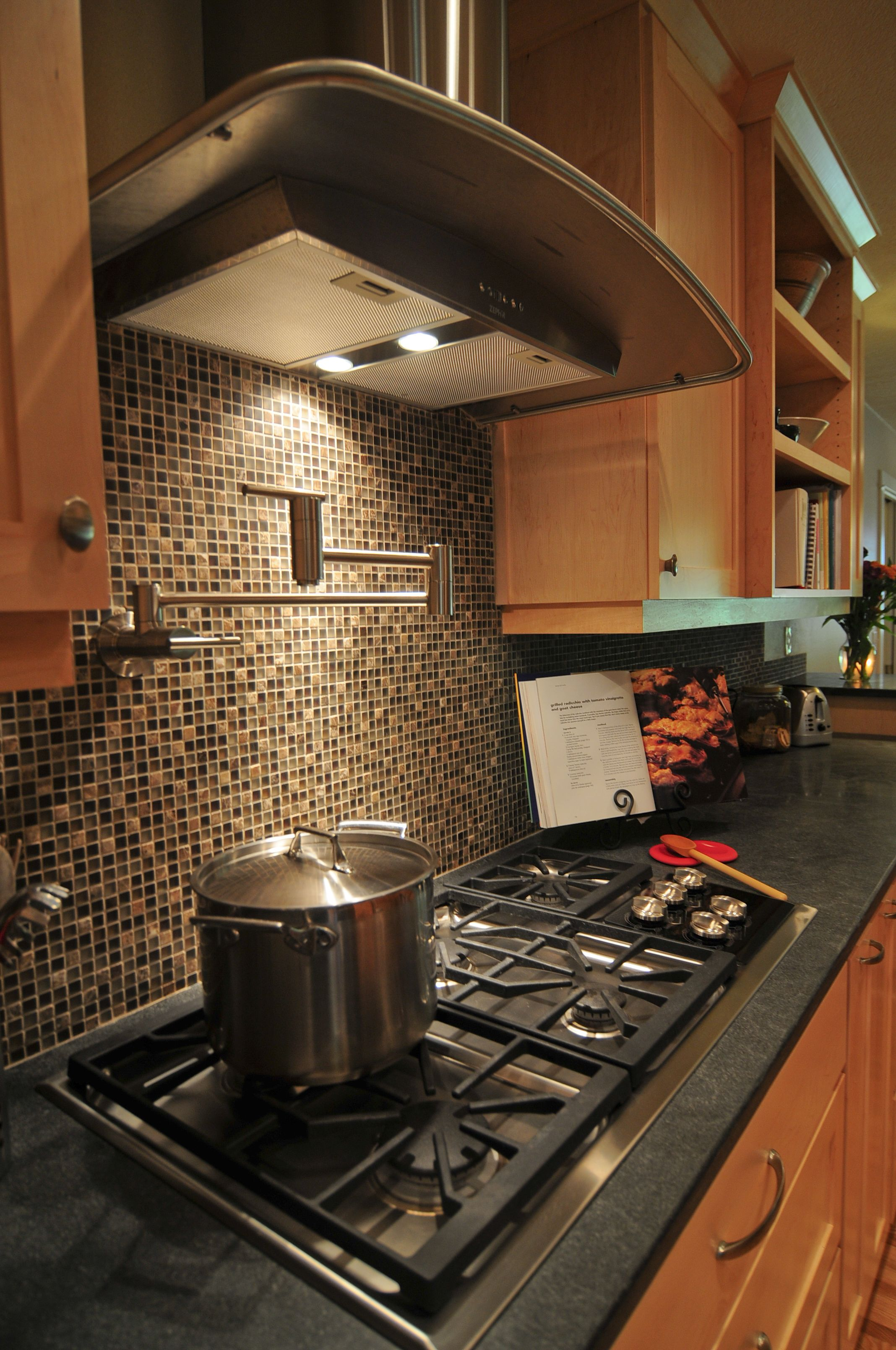 Small, mosaic backsplash complements the maple cabinets in ... on Natural Maple Kitchen Backsplash Ideas With Maple Cabinets  id=45280