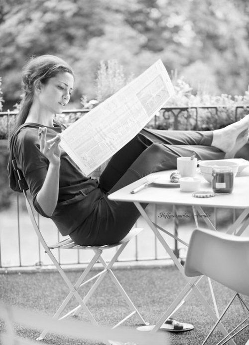 Woman reading the news paper, coffee, concentration, focus, beauty, silence, peaceful, photo b/w.