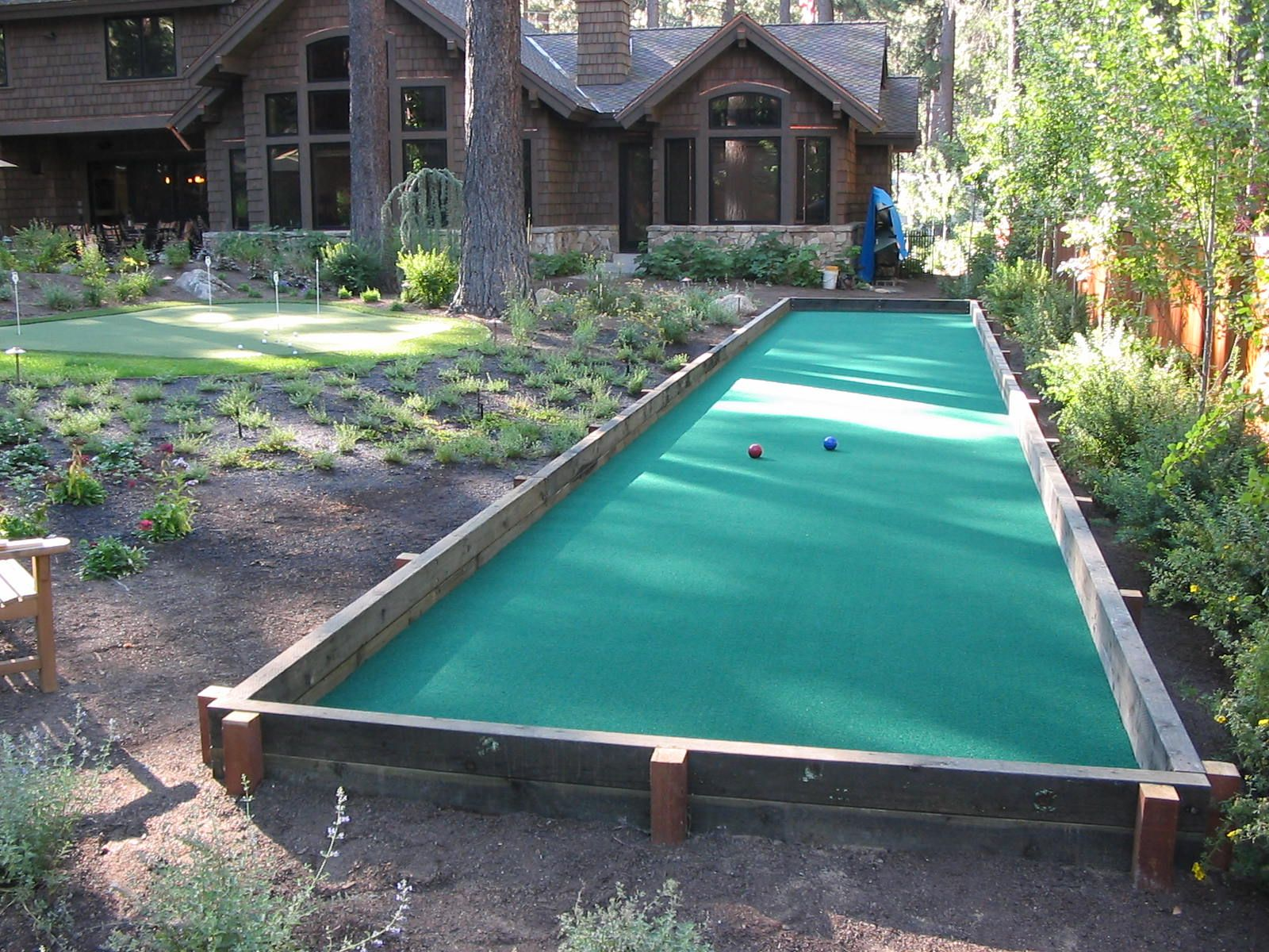 Bocce ball court with synthetic turf garden ideas for Backyard sport court ideas