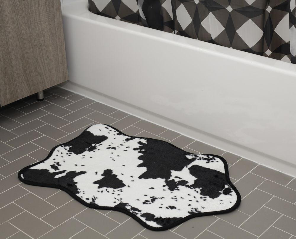 It Looks Like The Real Deal But This Bovine Bath Rug Is Made With An Ultra Soft Synthetic That S Suitable For Sidling Up Next To The Cow Skin Cowhide Bath Mat