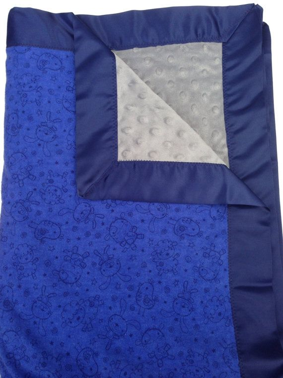 Any baby will fall asleep with this blanket! Blue baby blanket with baby animals on it.