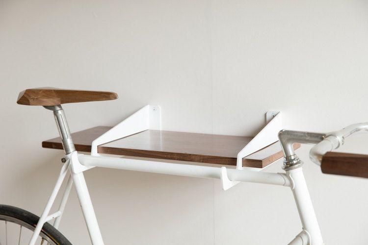 Velostirrups wall mounted bike rack and shelf by Quartertwenty