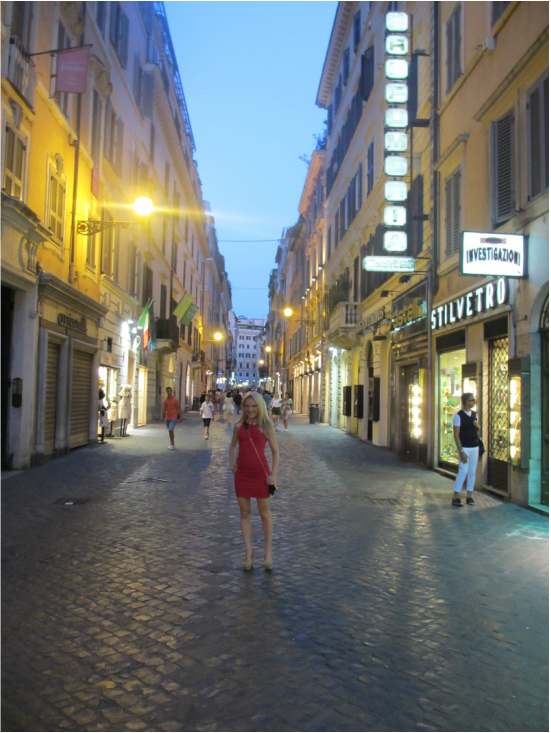 girl in red dress in the streets of Rome http://www.itgirlweddings.com/wifestyle/what-happens-in-rome