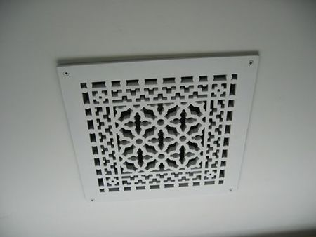 This could cover up ugly vents    decorative ceiling vent