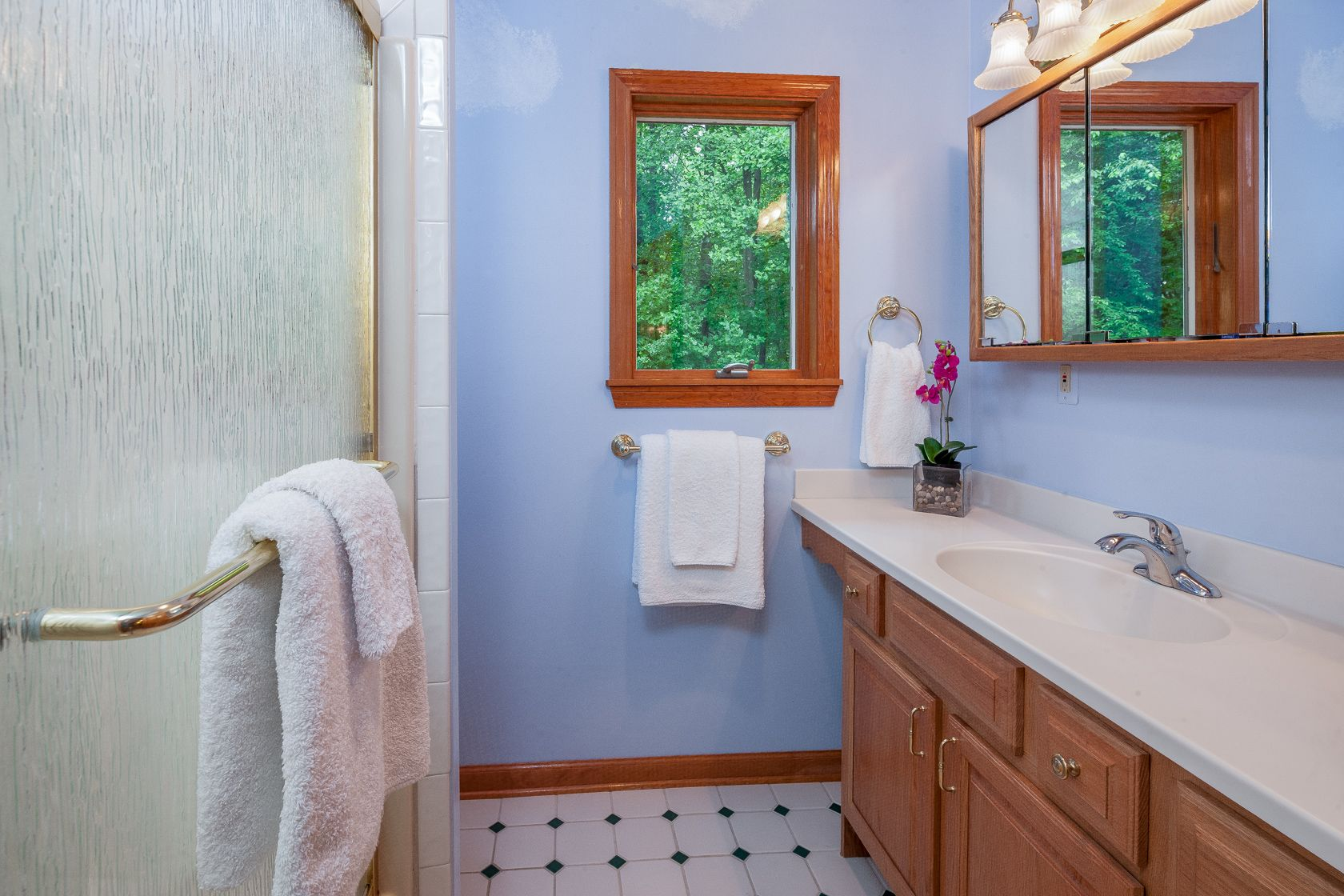 The Main Bathroom Features A Shower With Sliding Glass Doors Sliding Glass Door Bathroom Real Estate Marketing