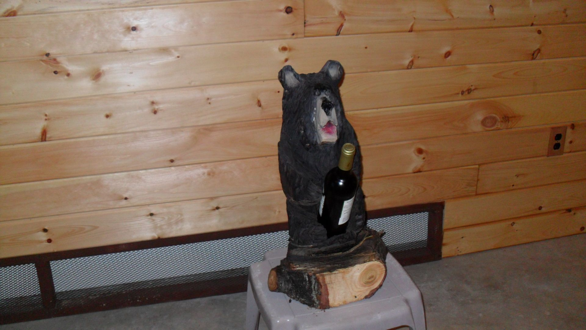 Chainsaw carved bear wine holder