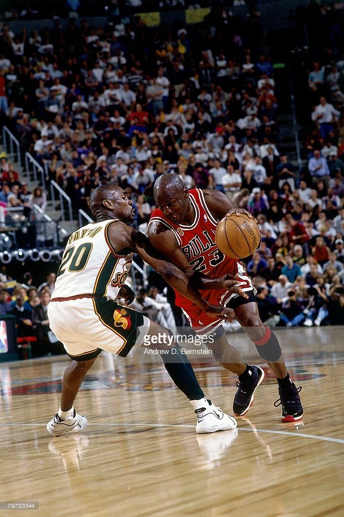 Michael Jordan  23 of the Chicago Bulls drives to the basket against Gary  Payton  20 of the Seattle SuperSonics in Game Five of the 1996 NBA Finals  at Key ... 45810e7d19b04