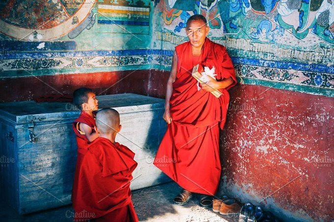 Tibetan Buddhist Monks prepared for chanting in Thikse Monastery. People Photos. $8.00