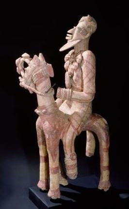 A terracotta figure of a man excavated in the Djenne/Mopti area. Most of these figures are found in wall cavities in the ruins of mud-brick houses. It is thought that they either represent devotees in household ancestral shrines or were intended to protect the house from flooding by the Niger. Culture: Djenne/Mopti. Date/Period: c.13-14th C. Place of Origin: Area between Niger and Bani Rivers. Credit Line: Werner Forman Archive/Formerly Entwistle Gallery, now Detroit Institute of Arts