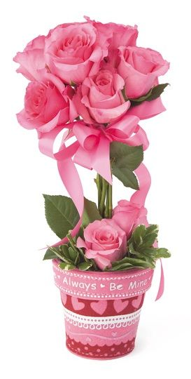 A cute valentines day arrangement in a themed pot. These touches ...