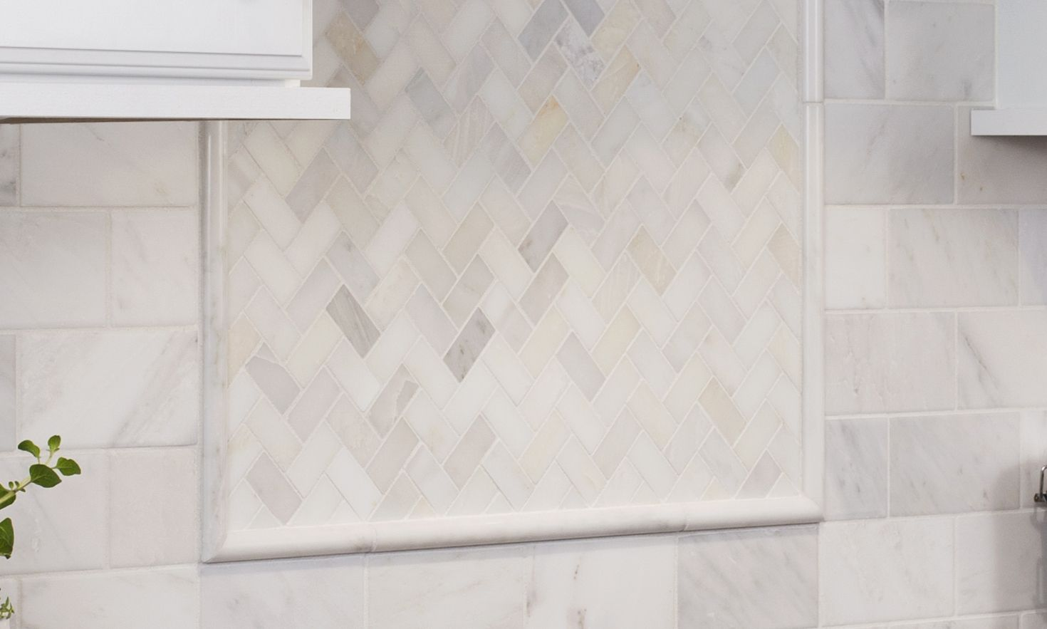 - The Marble Subway Tile With A Framed Herringbone Accent Above The