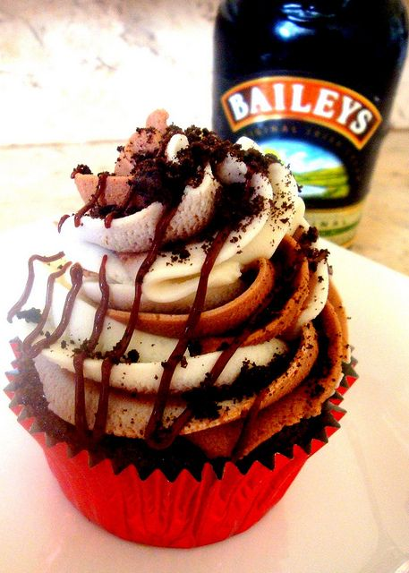 Mudslide Cupcakes...Dark Chocolate Cuppie dipped in coffee, w/Baileys n' Chocolate Swirl Buttercream drizzled with Ganache and topped with Oreo crumbles!