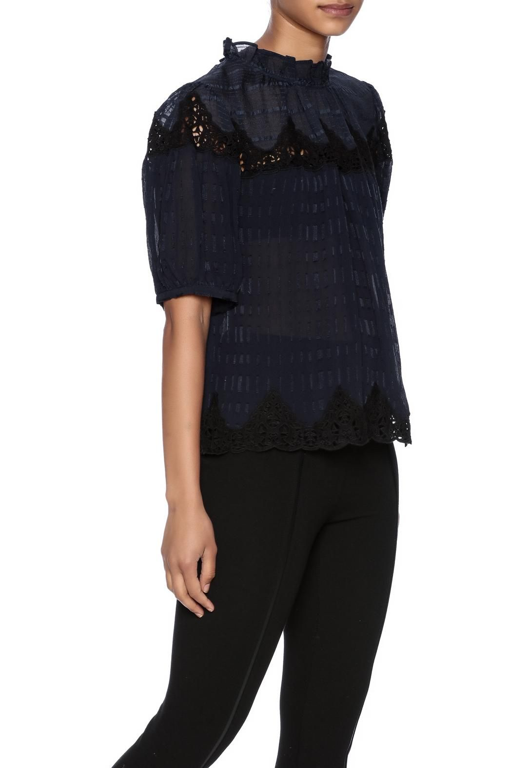 This semi-sheer blouse is masked with a tonal clip mix design and lace details. A stand up ruffle collar and billowy silhouette up the femininity. Single button closure at back with keyhole.     Clip Mix Top by Rebecca Taylor. Clothing - Tops - Short Sleeve Pennsylvania